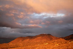 Soft beautiful sunset clouds over the red mountains in Tucson Arizona Stock Photo