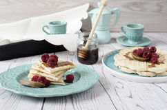 Soft Belgian heart shaped waffles with raspberries and figs, covered with honey on turquoise blue plate. Stock Image