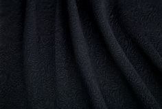 Soft black fabric. With embossed pattern patterns Royalty Free Stock Photography