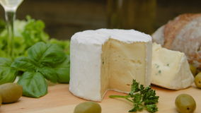 Soft blue cheese with bread, olives and herbs stock video footage