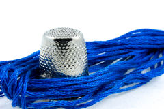 Soft blue cotton thread and a thimble Stock Photography