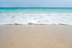 Soft blue ocean wave on sandy beach. Background. stock photography