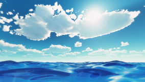 Sea waves under summer sky. Sea waves at summer. Soft cloudy sky in summer over the ocean or sea water. Puffy clouds at midday over calm blue sea or ocean waves