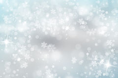 Soft blue snowfall with sparkle Royalty Free Stock Images