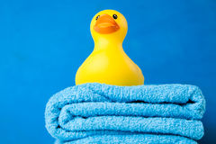 Soft blue towels and a toy duck Stock Photos