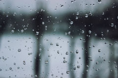 Soft and blur conception. Drops of water on the window in winter season. Background with drop of water closeup. Royalty Free Stock Images