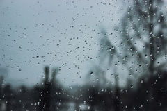 Soft and blur conception. Drops of water on the window in winter season. Background with drop of water closeup. Royalty Free Stock Image