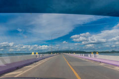 The soft blurred and soft focus photos while driving the car at the bridge of  Her Majesty Thepsuda,Lam Pao Dam,Kalasin province,T. The bridge of  Her Majesty Royalty Free Stock Image