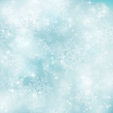 Soft and blurry pastel blue Winter, Christmas patt. Abstract soft blurry background with bokeh lights, snow flakes and stars. The festive feeling makes it a royalty free illustration