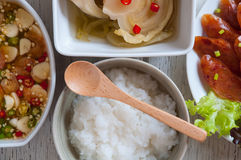 Soft boil rice with other food. In Thai style stock image