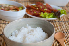 Soft boil rice with other. Food in Thai style Stock Photos