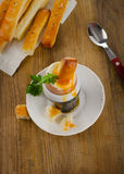 Soft boiled egg for Breakfast  served with bread on   a rustic w Royalty Free Stock Image
