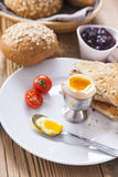 Soft-boiled egg in the morning with pepper, tomatoes and crouton Royalty Free Stock Images