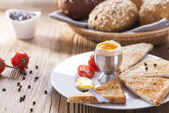 Soft-boiled egg in the morning with pepper, tomatoes and crouton Stock Photography