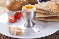 Soft-boiled egg in the morning with pepper, tomatoes and crouton Stock Image