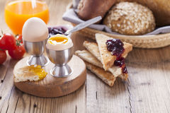 Soft-boiled egg in the morning with pepper, tomatoes and crouton Stock Photos
