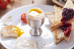 Soft-boiled egg in the morning with pepper, tomatoes and crouton Stock Photo