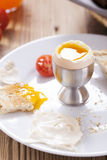 Soft-boiled egg in the morning with pepper, tomatoes and crouton Royalty Free Stock Photo