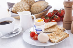 Soft-boiled egg in the morning with toast. In the background of Stock Photography