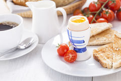 Soft-boiled egg in the morning with toast. In the background of Stock Image
