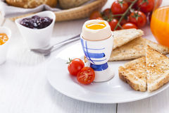 Soft-boiled egg in the morning with toast. In the background of Royalty Free Stock Image