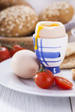 Soft-boiled egg in the morning with toast. In the background of Royalty Free Stock Images