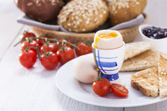 Soft-boiled egg in the morning with toast. In the background of Stock Images