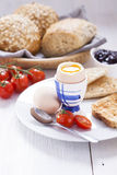Soft-boiled egg in the morning with toast. In the background of Royalty Free Stock Photos