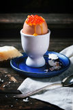 Soft-boiled egg with red caviar Stock Photo