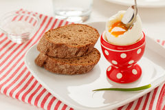 Soft-boiled egg in a red egg cup Stock Photo