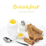 Soft-boiled egg, salt and toast on a plate Royalty Free Stock Photography