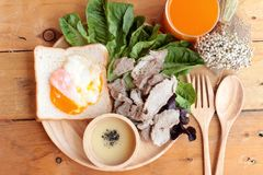 Soft-boiled egg on toast with sliced pork tenderloin. Royalty Free Stock Photo