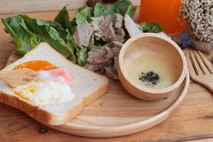 Soft-boiled egg on toast with sliced pork tenderloin Royalty Free Stock Images