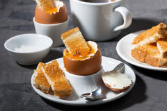 Soft boiled egg, toasts and coffee for breakfast Royalty Free Stock Photo