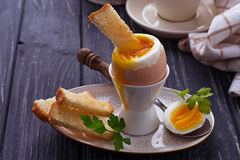 Soft-boiled egg and toasts Royalty Free Stock Images
