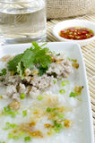 Soft-boiled rice pork with Glass of water and fish sauce Royalty Free Stock Image