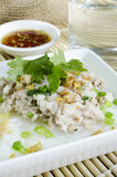 Soft-boiled rice pork with Glass of water and fish sauce Stock Photo