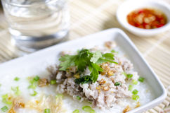 Soft-boiled rice pork with Glass of water and fish sauce Royalty Free Stock Photography