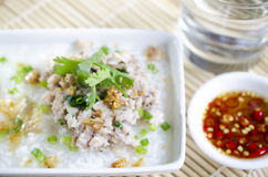 Soft-boiled rice pork with Glass of water and fish sauce Stock Image