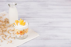 Soft breakfast with corn flakes, slice peach and milk bottle on white wood board. Decorative border with copy space. Soft breakfast with corn flakes, slice royalty free stock images
