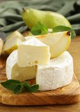 Soft brie cheese (camembert) with pears Royalty Free Stock Images