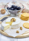 Soft brie cheese with crackers nuts and olives. Closeup Stock Photo