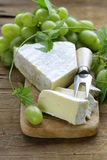 Soft brie cheese with sweet grapes Royalty Free Stock Photo