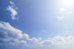 Soft and bright sun, white cloud, blue sky Royalty Free Stock Image