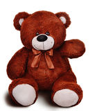 Soft brown classic teddy bear raising its hand Royalty Free Stock Image