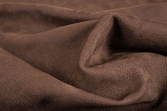Soft Brown Leather With Marks. Picture of bovine leather which can be used as a pattern or texture Royalty Free Stock Photos