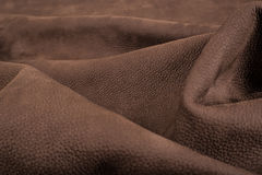 Soft Brown Leather With Marks. Picture of bovine leather which can be used as a pattern or texture Stock Image