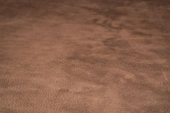Soft Brown Leather With Marks. Picture of bovine leather which can be used as a pattern or texture Stock Images