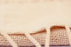 Soft brown woven fabrics background. Selective focus with shallow depth of field Royalty Free Stock Photography