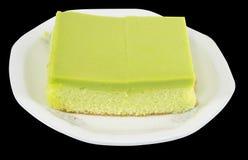 Soft cakeisolated on black background. Soft cake green leaf isolated on black background Royalty Free Stock Image